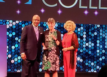 CCA President Betsy Oudenhoven receives the Advancing Diversity award from AACC officials