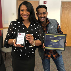 Community College of Aurora Foundation Development Director Lynn Adams and TRIO Academic Coach Melkamu Alemu show off the awards they received during the Honoring Black Excellence event on February 26.