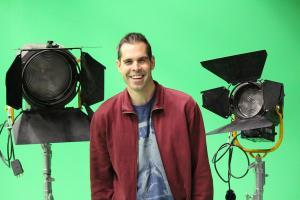Tom Dribble in front of green screen and cinama lighting