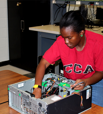 Chelsea Bailey works on a computer as part of CCA's IT Tech and Support program