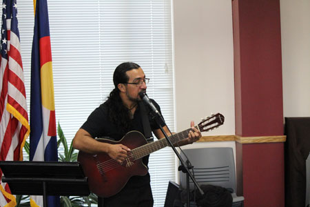 Adolfo Romero plays the guitar during International Village