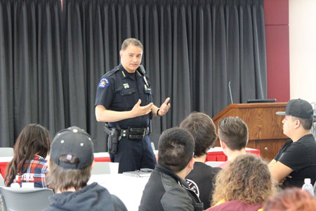 Aurora Police Chief Nicholas Metz speaks to CCA students