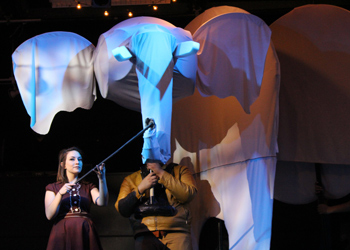 "Students Julia Harris and Miguel Rodriguez Rubio hold up an elephant prop as part of the production of ""Paradise Park Zoo"" in March."