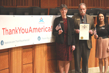 Betsy Oudenhoven, CCA President; Geoff Hunt, CCA Faculty; Sharona Grinsteiner, TYA Student with the proclamation.