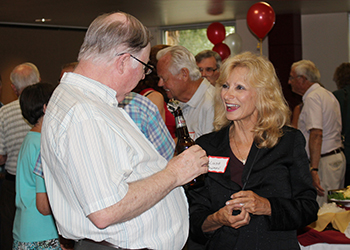 Former CCA presidents Linda Bowman speaks with a CCA pioneer at the CentreTech Celebration event