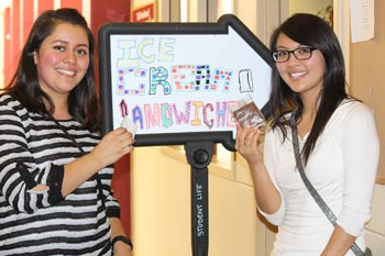 Students hold up ice cream sandwiches