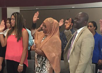 New U.S. citizens are sworn in at a citizenship ceremony at CCA
