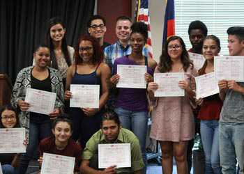 High school juniors proudly show their certificates for completing the Summer Bridge program at CCA