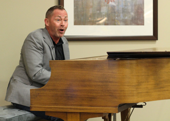 Michael Pickering plays the piano at the Healing Arts event at Aurora Medical Center