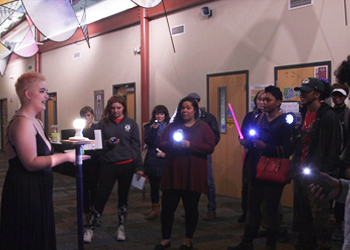 Dana Bergren speaks to a group of students during Ghostlight Project