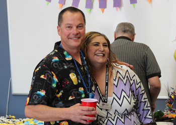 Mike Davis and Denise Oakeley pose during his retirement party