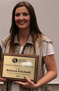 Rebecca Pritchard Displays Her Classified Employee of the Year Award