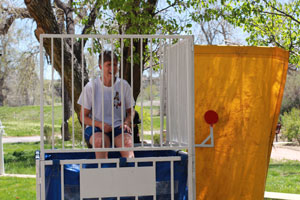 CCA President Betsy Oudenhoven sits in a dunk tank during Registration Nation