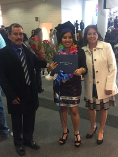 Kenya Trejo stands with her parents after graduating from Metropolitan State University.