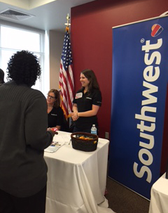 Representatives from Southwest Airlines meet with students and the general public during the Spring Career Expo