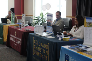 College representatives wait to speak to students at the CCA Spring Transfer Fair