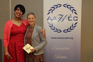 Stacey D'Angelo, pictured on the right, poses with her award