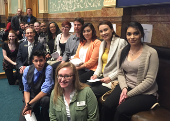 Kimberly Tenure poses with her students during a trip to the state capitol