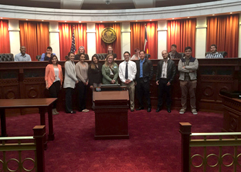 Kimberly Tenure poses with her students during a trip to the state supreme court