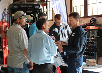 A representative from Power Motive Corp. speaks with potential students regarding the CCA Diesel Power Mechanics and its partnership with CCA at the Diesel Power Mechanics Open House on April 13.