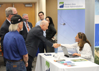 Mike Coffman greets a vendor at the Military and Veterans Expo