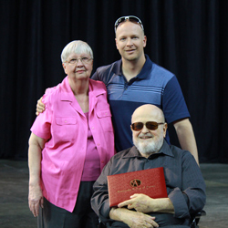 Setliffe Family Poses with the degree of their late son, Gregory