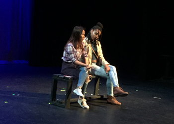 "Anisha Gurung (left) speaks with Adia Marble (right) on a bench during their performance of ""That First Fall"" during the Theatre Showcase on April 28."