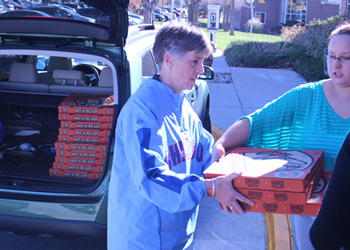 CCA President Betsy Oudenhoven delivers pizza to the CentreTech campus