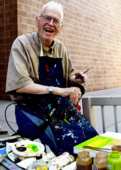 Eugene Meyer poses for a photo during the Plein Air painting session