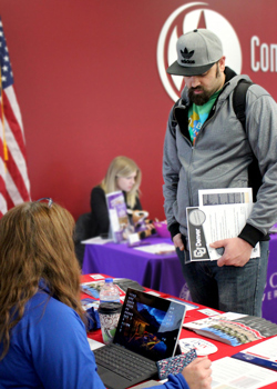 Student Robert Vincent asks a question to Audrey Jones, a transfer admissions counselor from Metropolitan State University of Denver during the Fall Transfer Fair held on the Lowry campus on November 2.