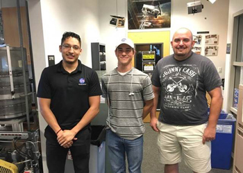 Former CCA students pose for a photo at the Colorado Space Grant Consortium offices
