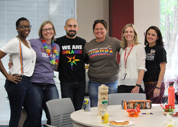 CCA staff posing for a photo during National Coming Out Day