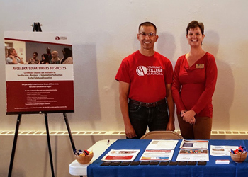 Valerie Gantzler, coordinator for the Accelerated Pathways to Success program, and her husband, Armando, represented CCA during an event at the Village Exchange Center on September 23.
