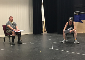 "Phamaly actor Paul Migliorelli, left, and CCA student Miles Groberg rehearse their lines for ""Vox: Under Construction"" on Sept. 21 in the Larry D. Carter Theater on the CentreTech campus."