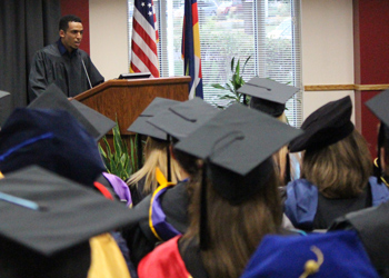 Student Government Association President Eaba Dechasa spoke during Convocation to assembled faculty and staff