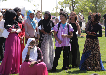 A group of young people engage with one another during Global Fest