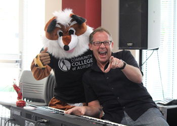 The Red Fox mascot and Music Director Michael Pickering entertaining during Mixer Monday.