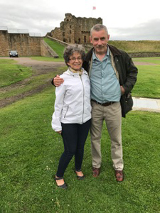 (Photo; right) Kim Harrell and her husband, David, stand near the Abbey in Tynemouth, England.
