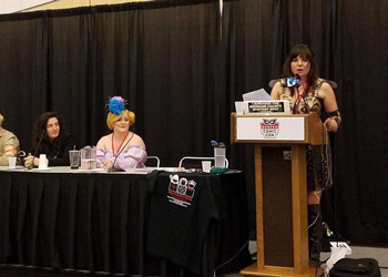 Tanya Cook speaking to a group at Denver Comic Con