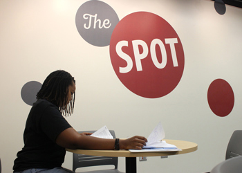 A student studies at the campus hangout, The Spot