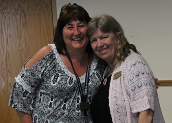 Catherine Trouth poses for a picture with Angie Tiedeman during Catherine's goodbye party