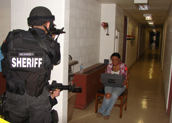 Officers go through a simulation in a hallway at the Disaster Management Institute.
