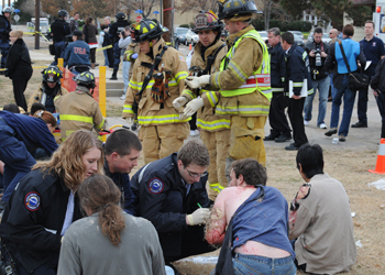 Paramedica and firefighters tend to simulated victims during an exercise at the Disaster Management Institute.