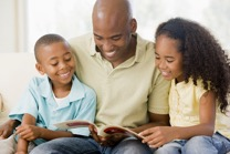 A father reading with his children