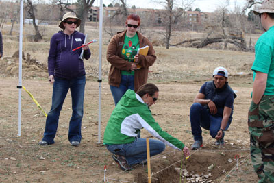 Students uncover bones as part of the CSI: Aurora project in spring 2016