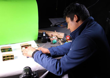 Oliver Maceda, a junior at DSST: Conservatory Green High School, works on a stop motion film project at the Colorado Film School on July 10.