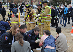 Firefighters consult during a mass casualty exercise
