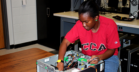 IT Tech and Support student Chelsea Bailey works on taking apart a computer