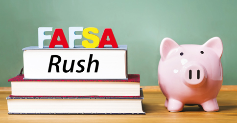 FAFSA letters on top of a textbook with a piggy bank next to it