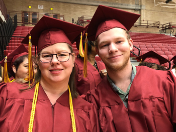 Tracy Geiler and her son Ian Campian-Geiler in their graduation gear at Commencement